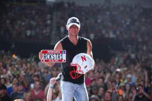 Kenny holding Husker gear! represent!! :)